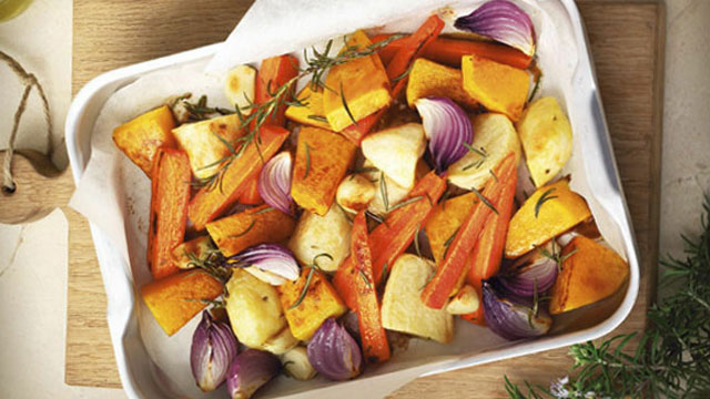 roast variety of vegetables in white dish.