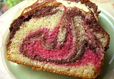 A cut side of three coloured marble cake.