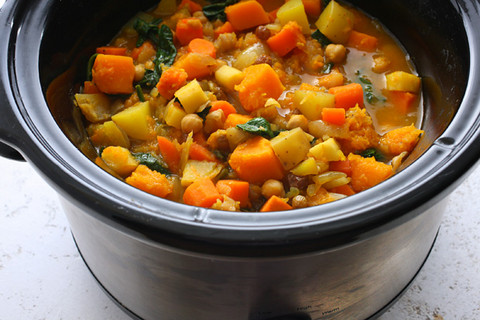 Colourful vegetable soup in slow-cooker bowl.
