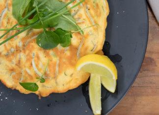 Golden whitebait fritter on dark plate