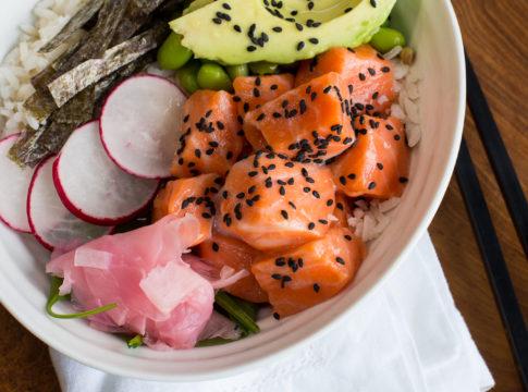 Easy to make salmon poke bowl with ginger, radish, and avocado