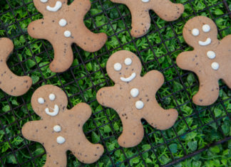 healthy ginger bread men laid onto of green grass