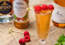 Redcurrant and Rose Spritzer garnished with raspberries