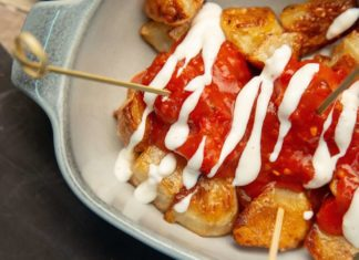 Raosted potatoes smothered in sauce