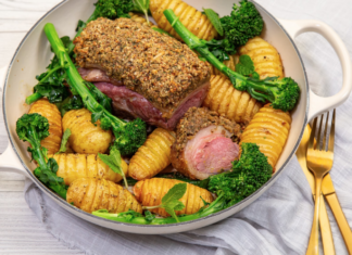 Roast Lamb onto pf colourful vegetables