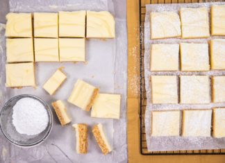 Top view of pale yellow square slices on wire rack and on marble surface next to each other with a small dish of white powder and some side view of the slices.