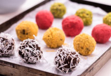 12 colourful balls on a tray