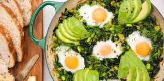 Green Shakshuka with eggs and avocados