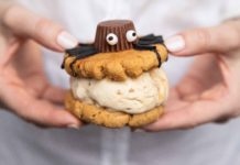 hands holding a cookie sandwich