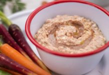 almond coloured dip in a small pot and baby carrots