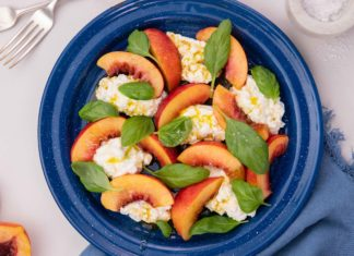 nectarine pieces and drops of cheese on a blue round plate