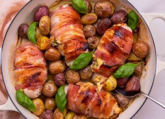 cooked bacon wrapped chicken breasts in a casserole pan