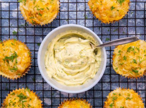 pot of soft dill butter and muffins on a wire rack