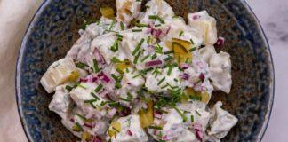 potato salad in dark blue bowl