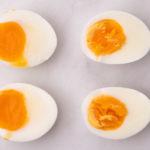 4 boiled egg halves on marble bench top