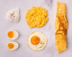 5 kinds of cooked eggs on white marble bench top