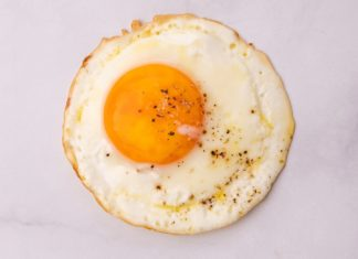 One fried egg on white marble bench top