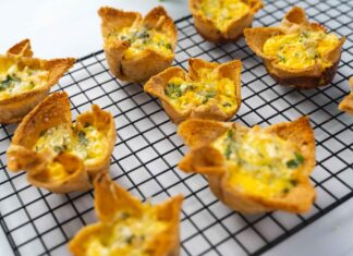 9 mini bread cup quiches on wire rack over white board