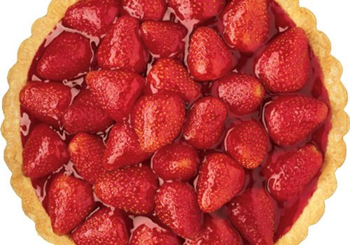 Top view of a round strawberry pie.